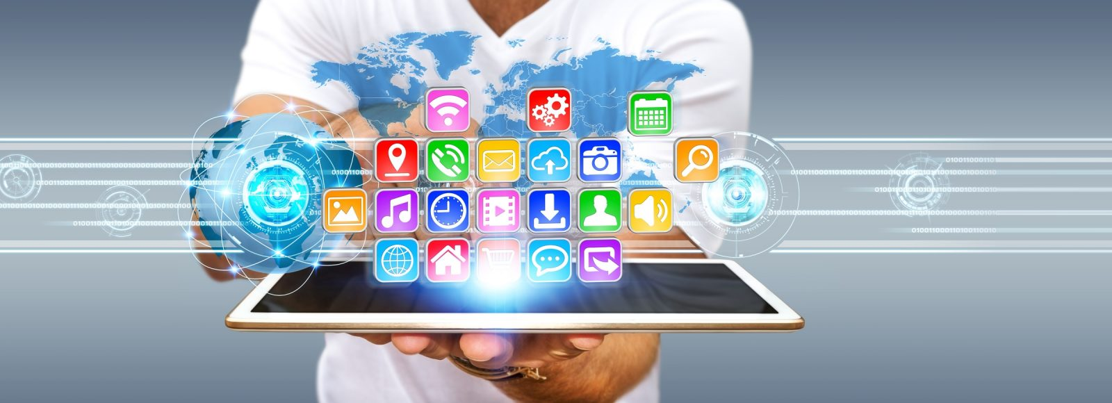 Young man using digital application with icons flying over his tablet